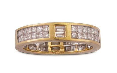 A gold and diamond eternity ring