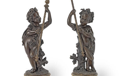 A pair of 19th century French patinated bronze figures of Bacchanalian putti