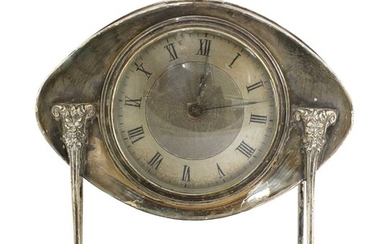 An Arts and Crafts silver-plated desk clock