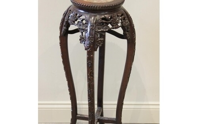 An early 20th century Chinese carved hardwood and rouge marb...