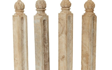Four Mughal columnar shaped carved marble posts with finials in the shape of a closed lotus bud, India, period of Muhammad Shah, circa 1740, the front and back of each post plain with a single incised line forming a frame, carved to either side...
