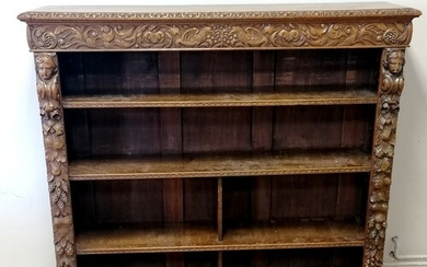 Victorian carved oak Gothic style open bookcase with foliate...