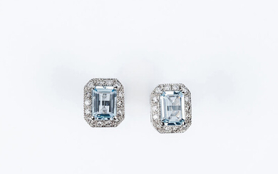 White gold earrings with a rectangular topaz center, claws,...
