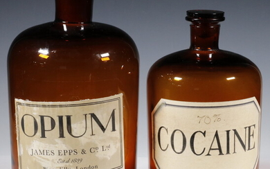 (2) BROWN GLASS APOTHECARY JARS WITH STOPPERS, OPIUM & COCAINE