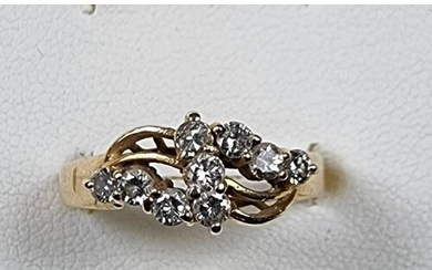 A 14k gold and diamond dress ring size N, 3.5 gms.