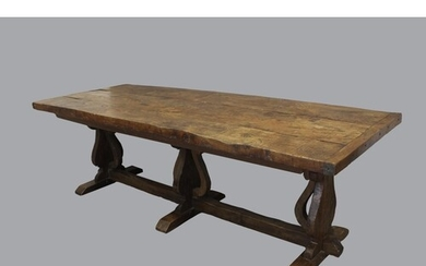 A 17TH CENTURY STYLE ELM TOPPED REFECTORY DINING TABLE. With...