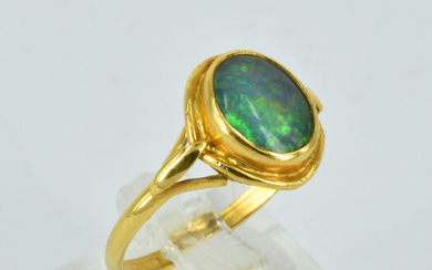 A 9CT GOLD AND OPAL RING