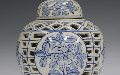 A Chinese Provincial blue and white pottery ginger jar and cover, 20th century, the globular body pa