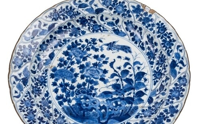 A Chinese blue and white charger: the centre painted with tw...