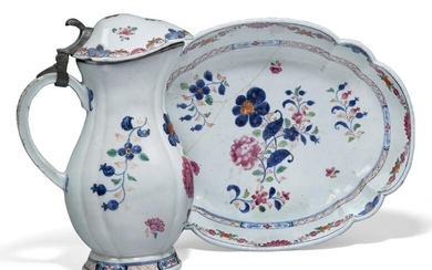 A Chinese export porcelain famille rose lidded jug and dish, 18th century, both painted with flowering blossoms amidst leafy stems, the jug 25cm high, the dish 30cm long (2) Provenance: From the collection of an important Greek shipping family