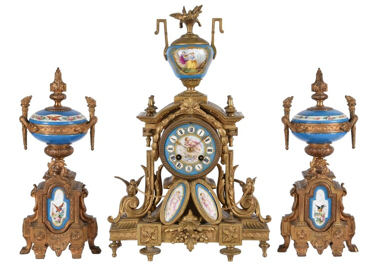 A FRENCH GILT METAL AND PORCELAIN MANTEL CLOCK