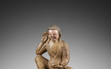 A RARE CARVED AND PAINTED LIMESTONE FIGURE OF MILAREPA, 15TH-16TH CENTURY