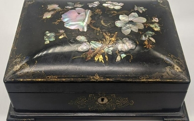 A Victorian black lacquered box inlaid with mother of