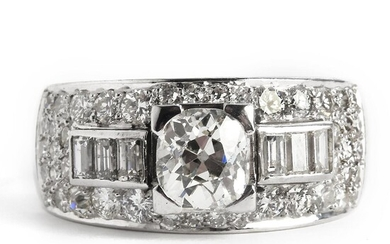 A diamond ring set with an old-cut diamond weighing app. 1.20 ct. encircled by brilliant-cut diamonds weighing a total of app. 2.75 ct., mounted in platinum. – Bruun Rasmussen Auctioneers of Fine Art