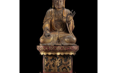 A large gilt-wood carved seated Buddha, on a associated carved base (defects and losses) China, Ming dynasty, 17th century (h.…Read more