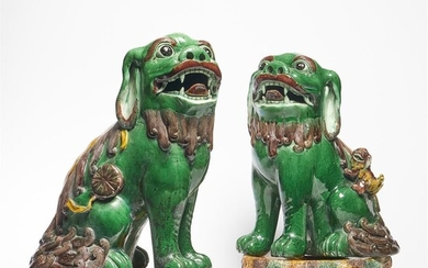 A large pair of Chinese Famille Verte Buddhistic Lions