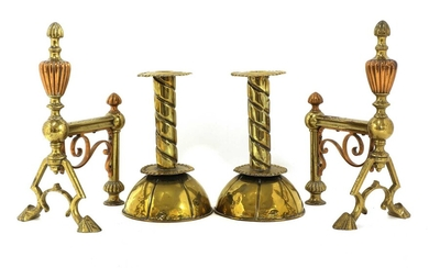A pair of Arts and Crafts brass candlesticks