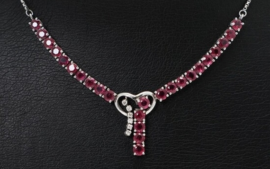 A ruby and diamond necklace set with numerous circular-cut rubies and six brilliant-cut diamonds, mounted in 14k white gold. L. 38 cm. – Bruun Rasmussen Auctioneers of Fine Art
