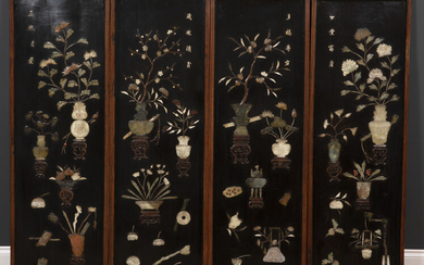 A set of four decorative Chinese black lacquered panels