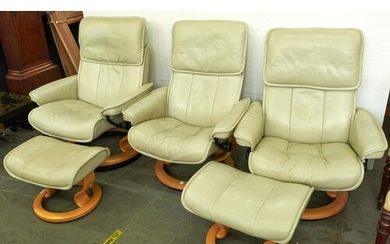 A set of three Stressless cream leather armchairs and a pair...