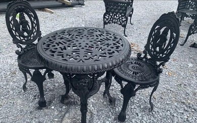 Cast iron three piece garden set - table and two chairs.