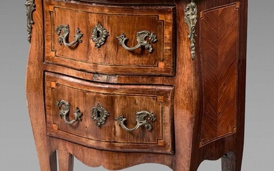 Chest of drawers with curved front opening to two drawers...