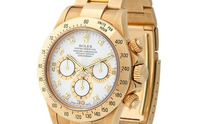 Rolex. Very Rare and Luxurious Daytona Chronograph Wristwatch in Yellow Gold, Reference 16 528, With White Diamonds Dial and Sticker