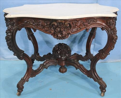 Rosewood rococo center parlor table by A. Roux