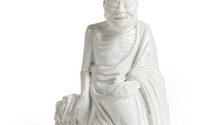 WHITE-GLAZED FIGURE OF AN ARHAT QING DYNASTY, 18TH-19TH