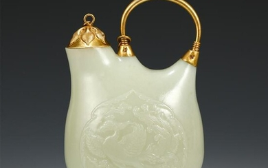 A CHINESE CARVED PHOENIX PATTERN JADE EWER WITH GILDING