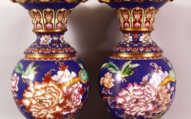 A PAIR OF CHINESE CLOISONNE VASES - with a deep royal blue g...
