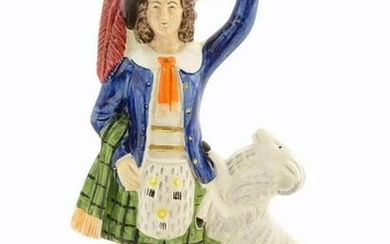 A Staffordshire pottery figure of a Highland man