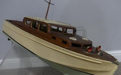 A Vintage 1950's electric Pond motor Boat, painted wood and ...