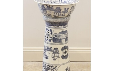 A blue and white jardinière and stand, 20th century, the jar...