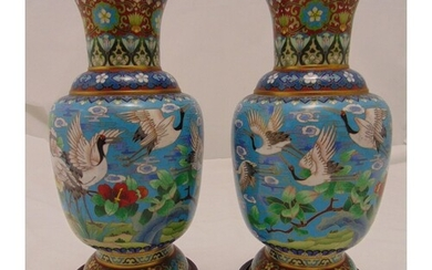 A pair of oriental cloisonné vases of baluster form, the sid...