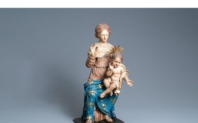 A polychromed wooden figure of a Madonna with child, 17th C....