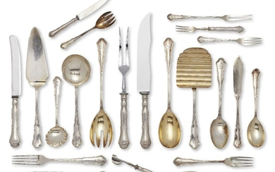 A set of German flatware for five, stamped 800, designed with shaped scrolling terminals engraved with the initial 'F', the set comprising five each: table forks, table knives, table spoons, fish knives, fish forks, dessert forks, dessert knives...