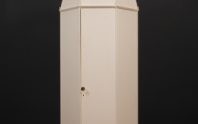 A small octagonal white painted wardrobe