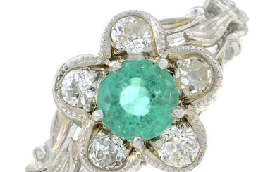 An emerald and old-cut diamond floral cluster ring.