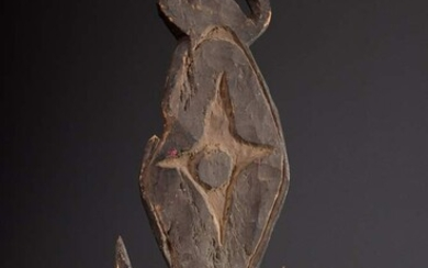 Hanging hook with central star motif, face in relief and...