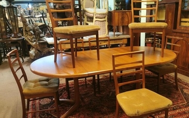 Mid-century extending dining room table with set of eight ma...