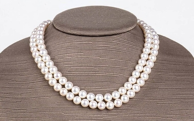 Pearls and diamonds necklacetwo strands of satltwater cultured pearls (Akoya pearls), 18k white gold floral...