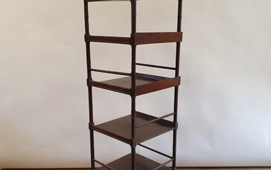 A 19th century mahogany four tier whatnot, with a drawer to ...