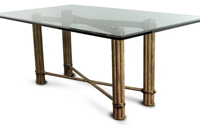 A Contemporary dining table having a beveled glass top