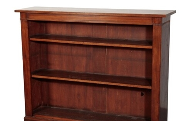 A REGENCY MAHOGANY OPEN BOOKCASE of rectangular form with tw...