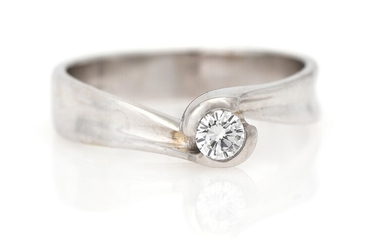 NOT SOLD. A diamond solitaire ring set with a brilliant-cut diamond weighing app. 0.20 ct.,...