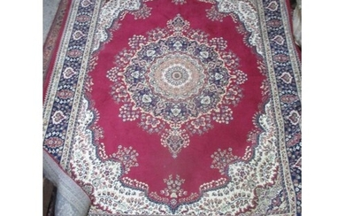 A group of three Middle Eastern woven rugs, two being red gr...