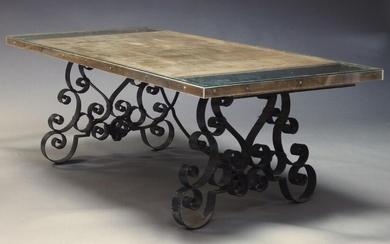 A large French wrought iron garden table, early 20th Century, with rectangular oak parquetry top, on scroll work wrought iron supports, 75cm high, 236cm wide, 101cm deep