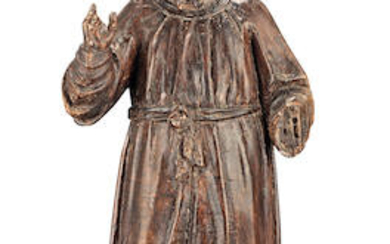 A late 16th/early 17th century Italian carved and stained walnut statue of Christ