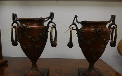 A pair of Early 20th century French bronze urns, with ring h...